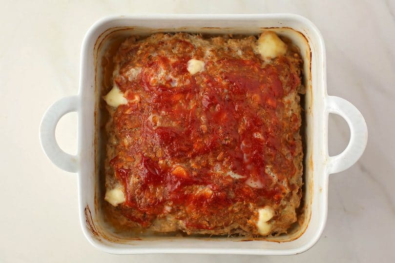 baking dish with freshly baked meatloaf