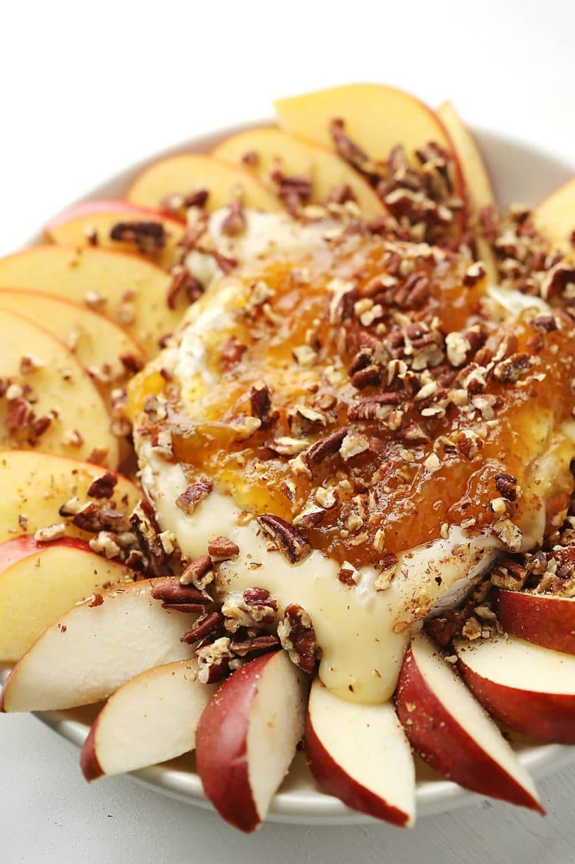 melted cheese with sliced apples and jam