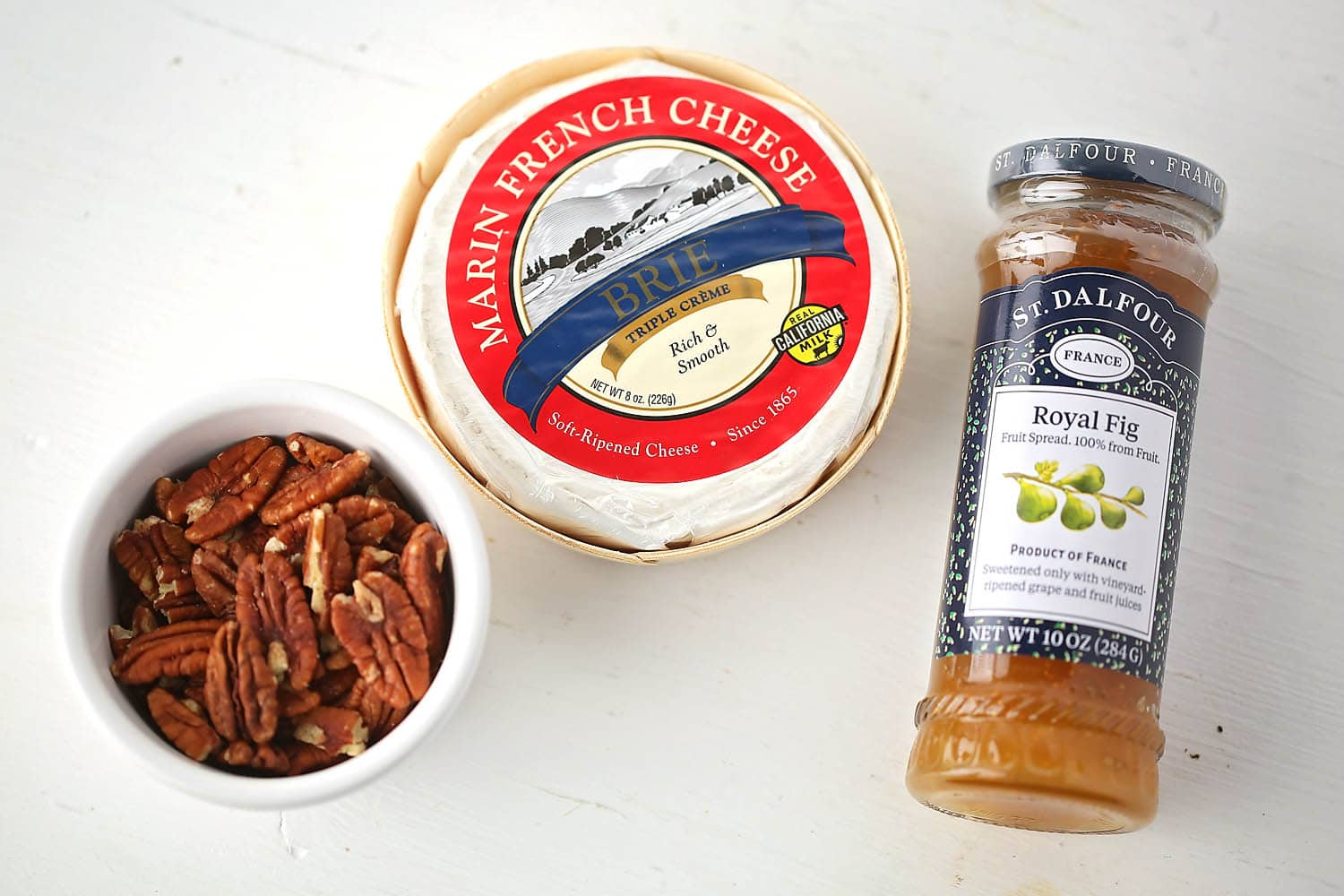 jam, brie cheese and jar with pecans
