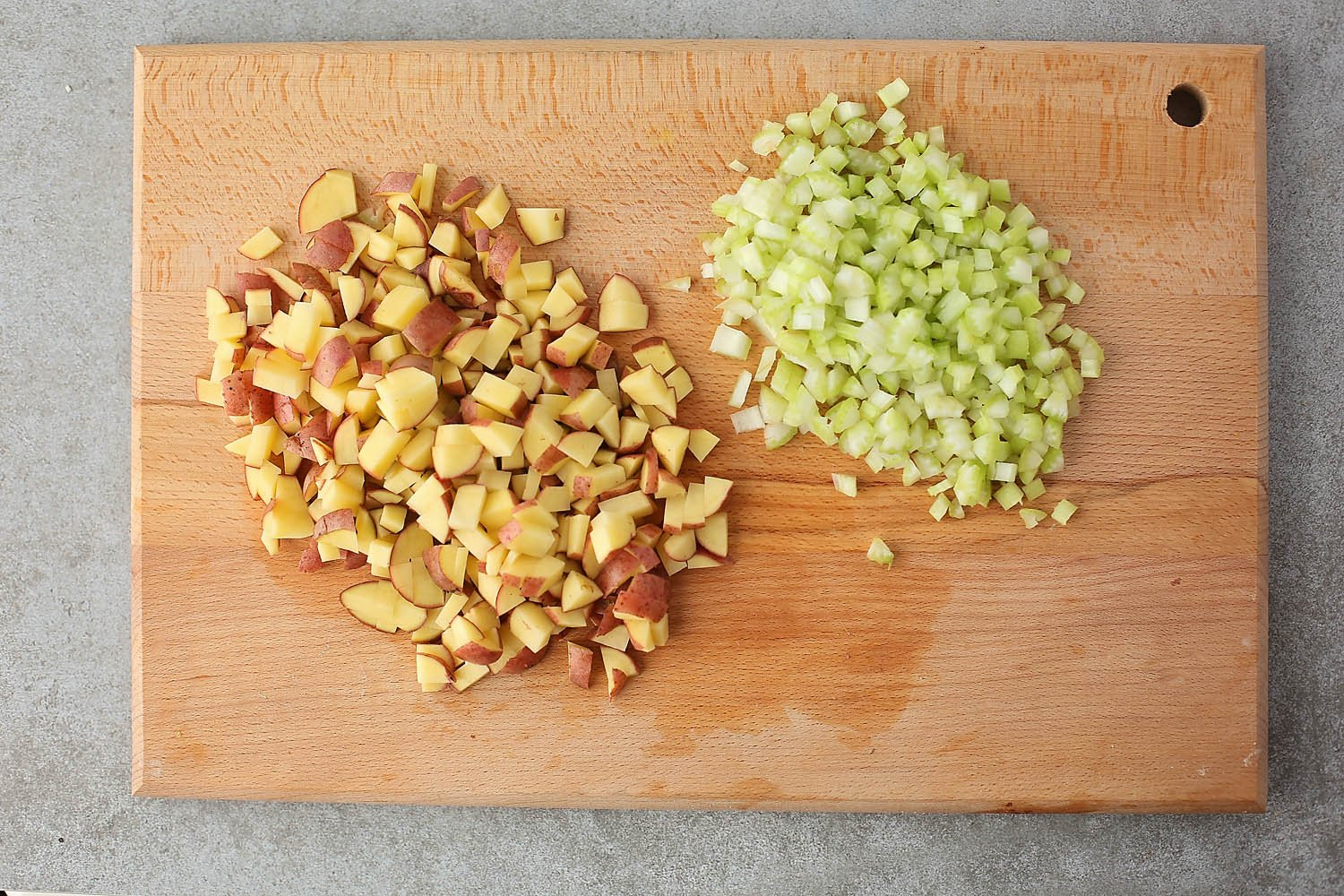 cutting board with diced potatoes and celery