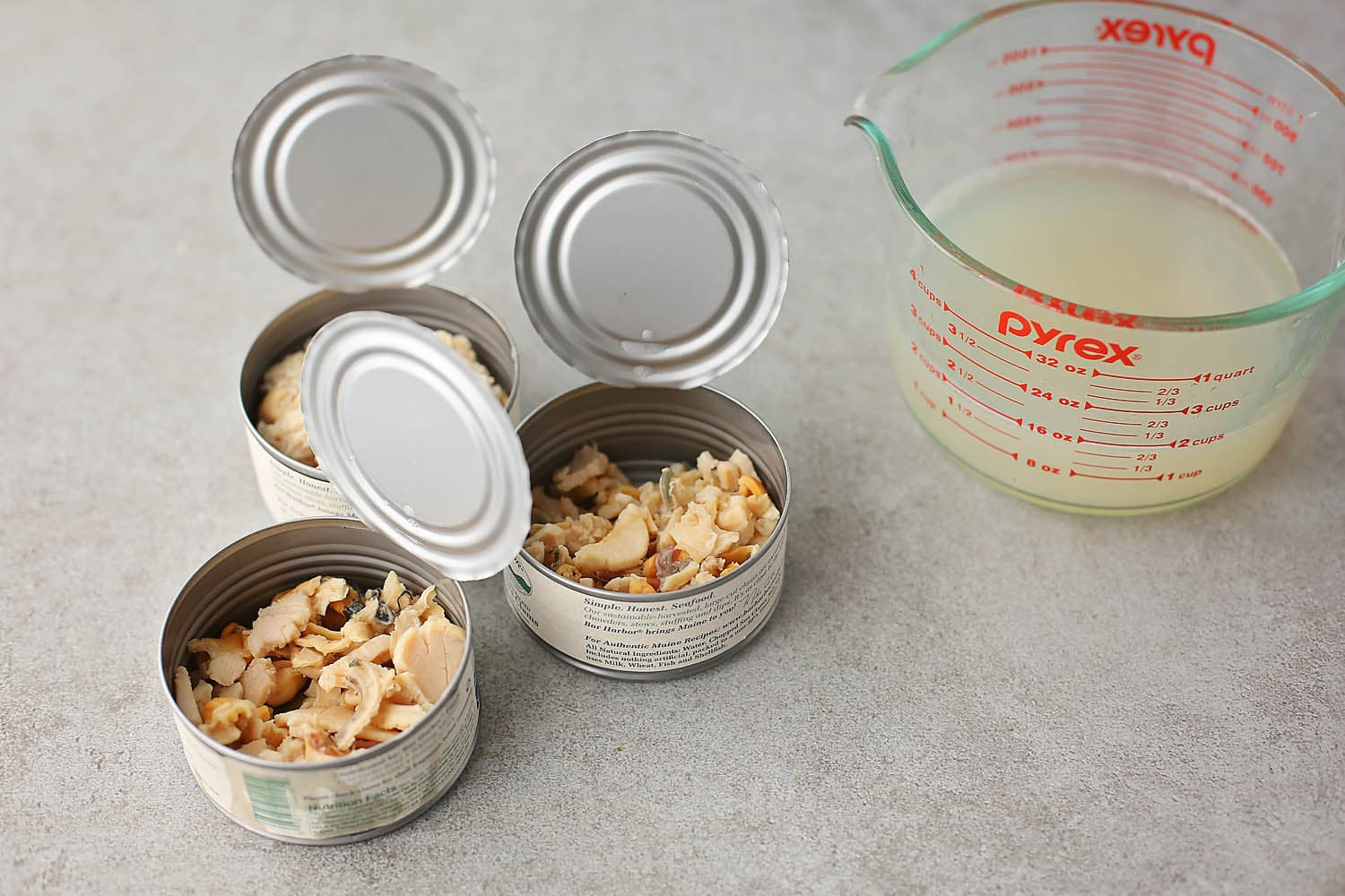 three open cans with clams