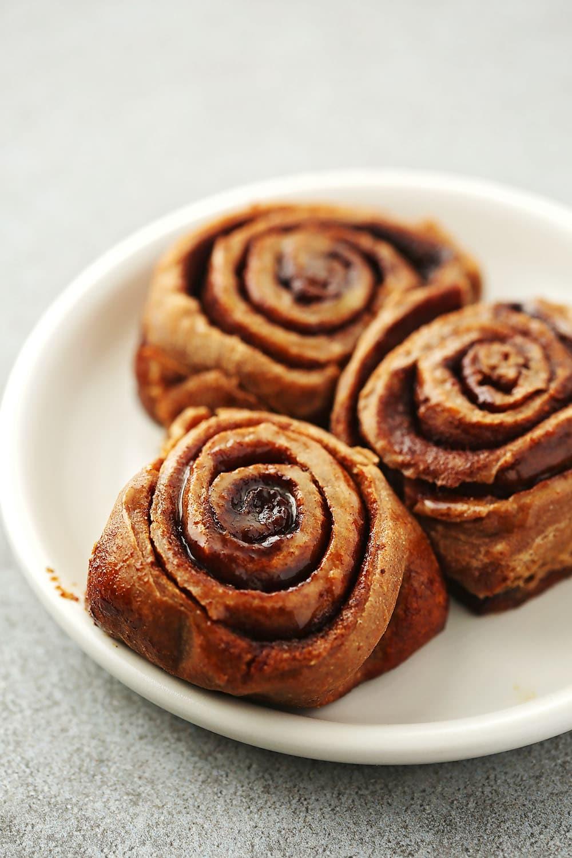 plate with three cinnamon rolls