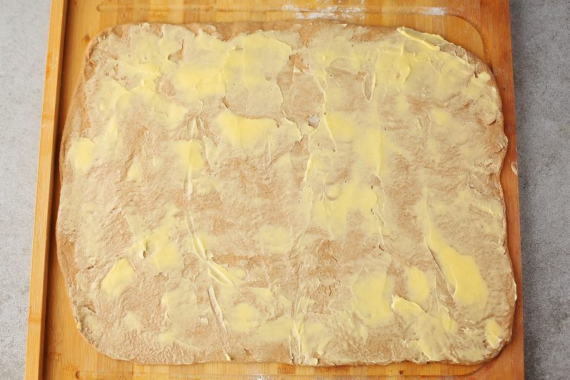 rolled out dough with spreaded butter on top