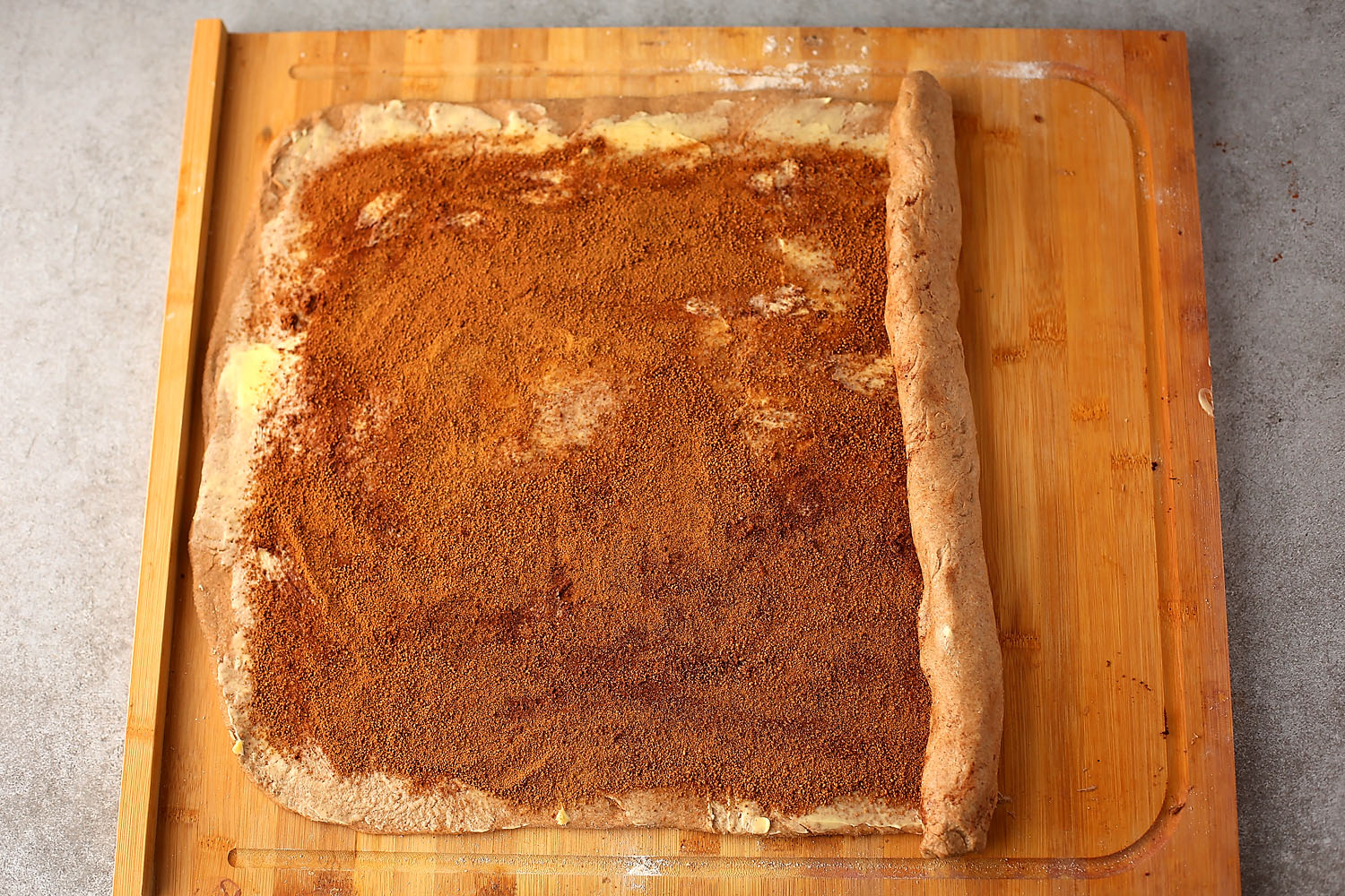 rolled dough with cinnamon mixture on top