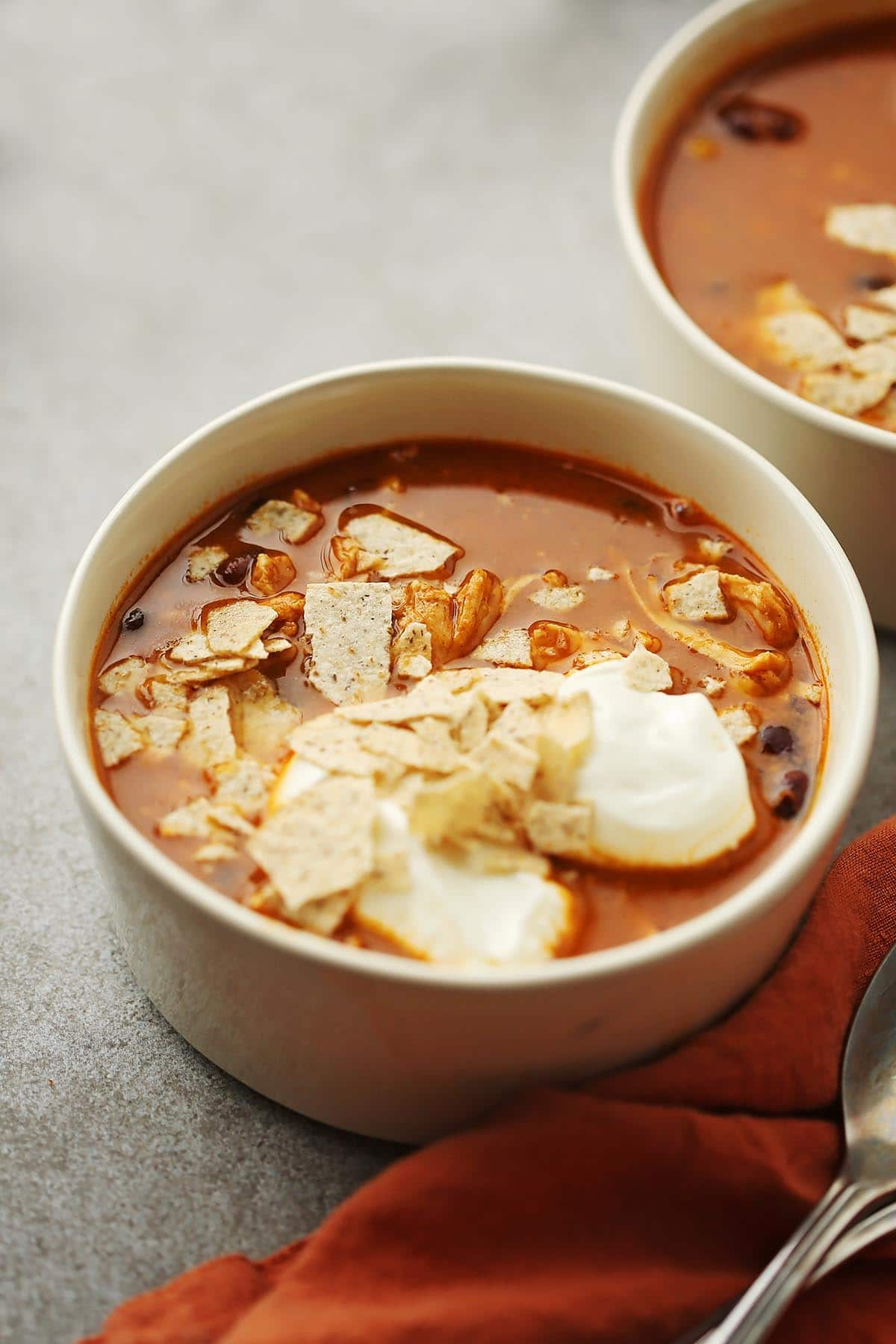 bowl with red soup and toppings