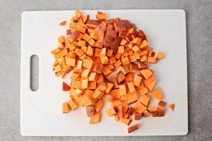 cubed sweet potatoes on a cutting board