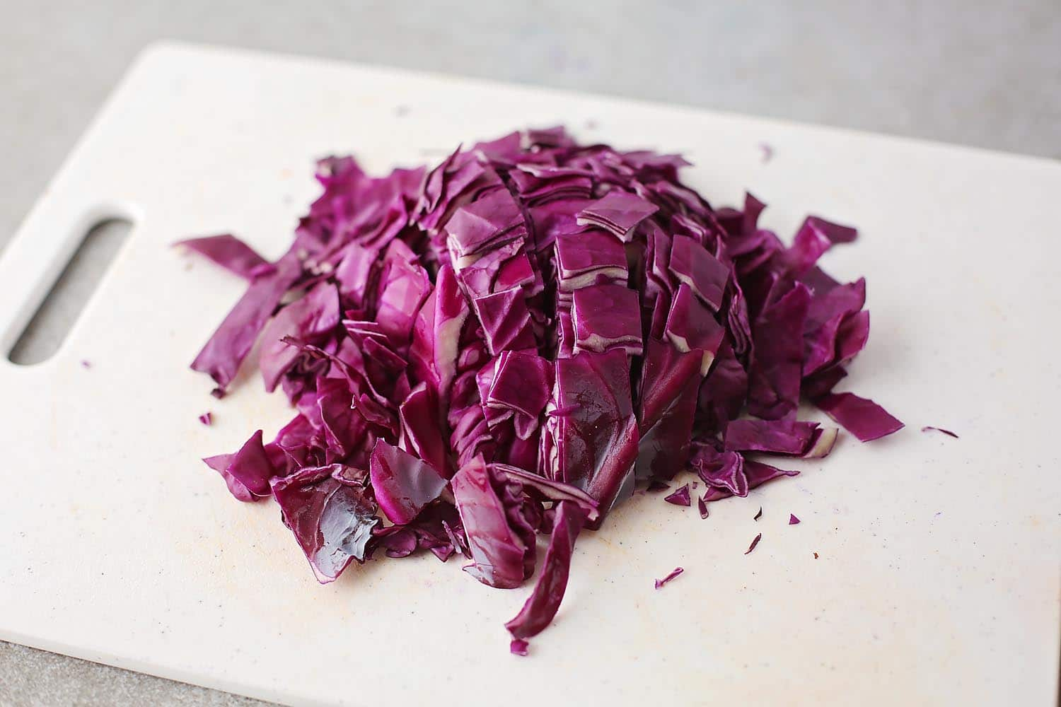 sliced purple cabbage on the cutting board