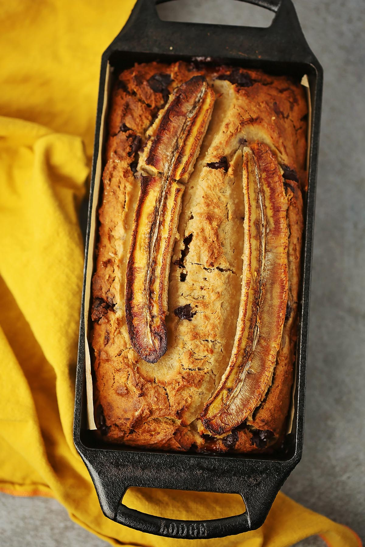 loaf pan with bread topped with baked banana