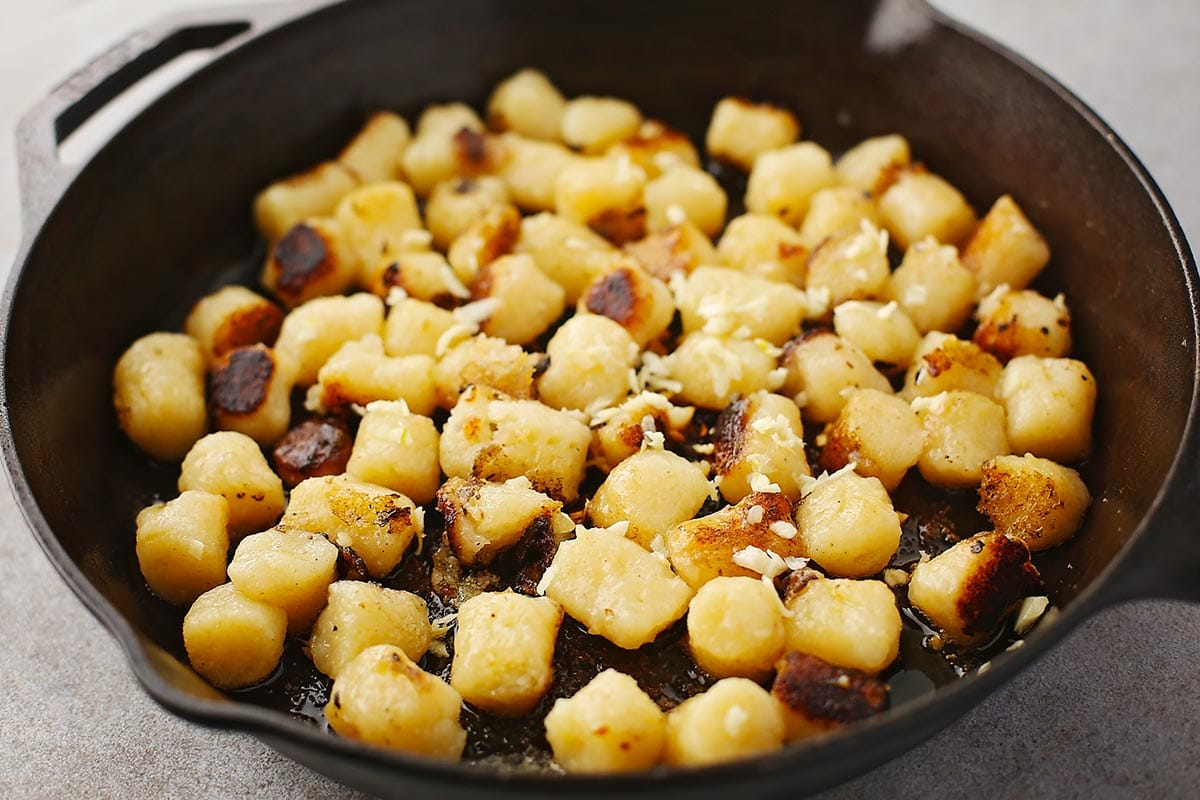 cast iron skillet with browned gnocchi