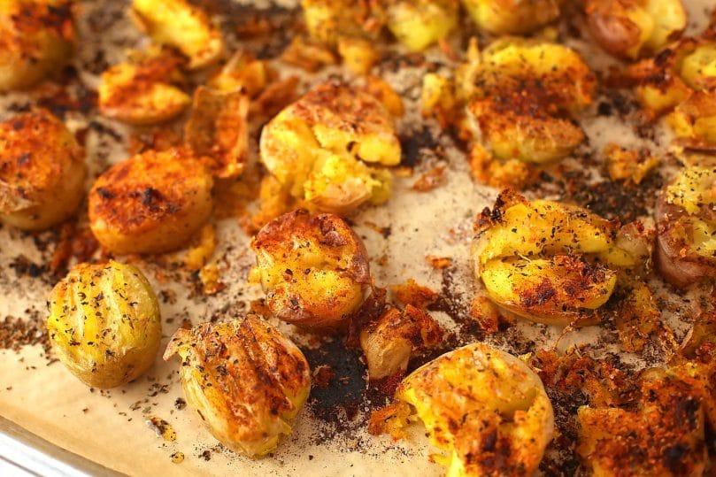 crispy baked potatoes laying on the sheet pan