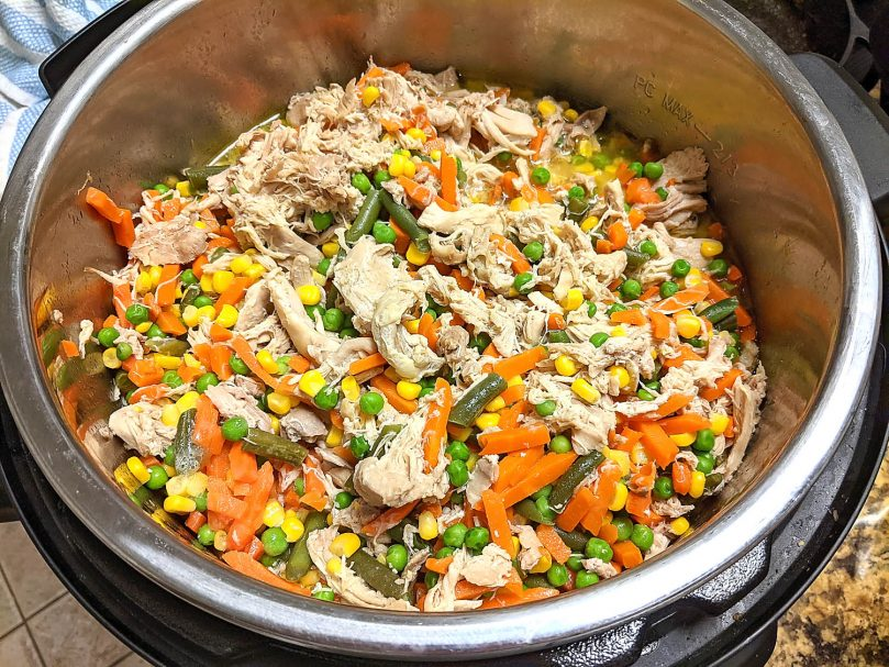 instant pot with cooked chicken and vegetables