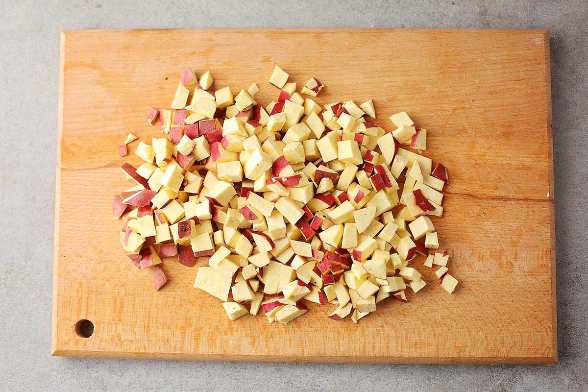 diced potatoes on a wooden board