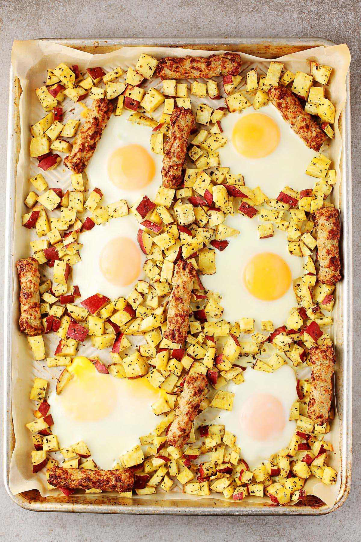 sheet pan with cooked eggs, sausage and sweet potatoes