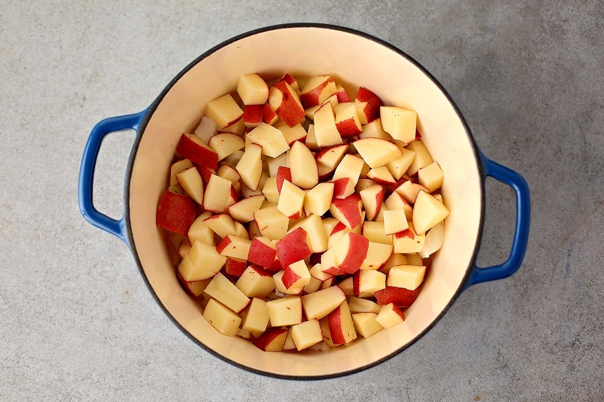 dutch oven with cubed potatoes