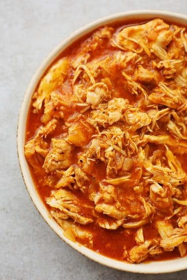 plate filled with shredded chicken in BBQ sauce