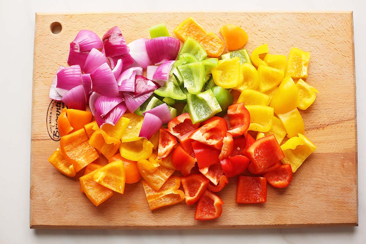 cutting board with sliced colorful bell peppers