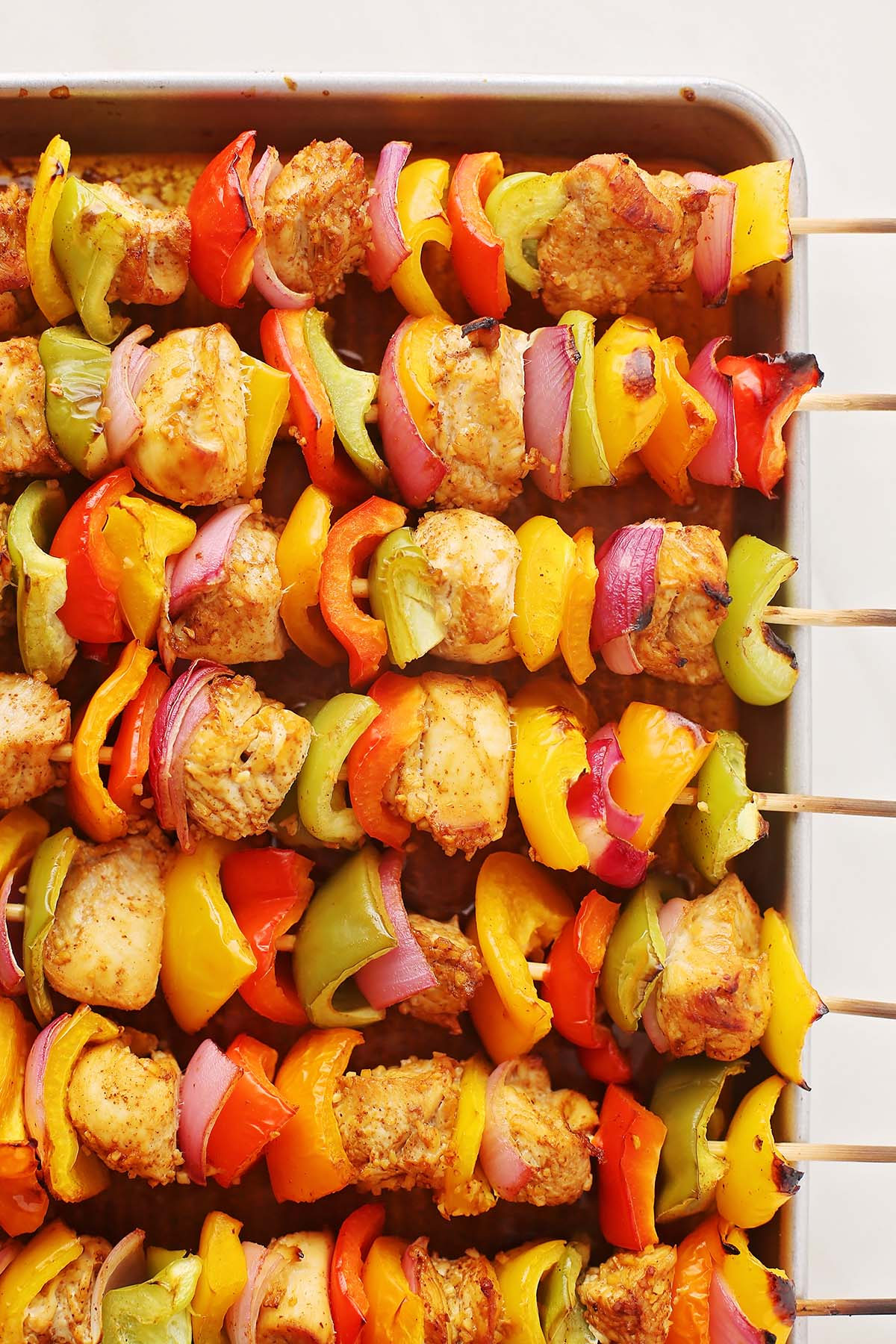 wooden skewers with chicken and bell peppers