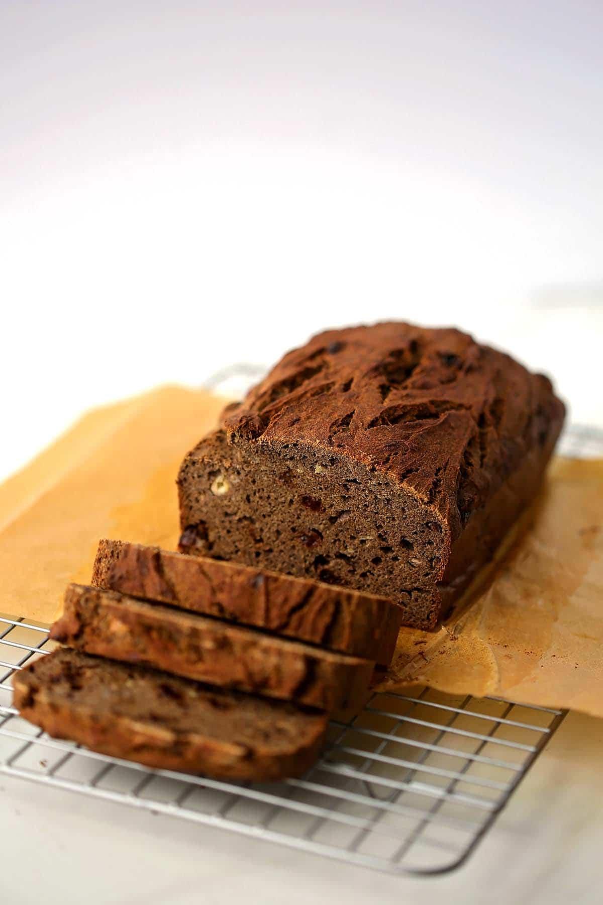 banana bread sliced on the cutting board