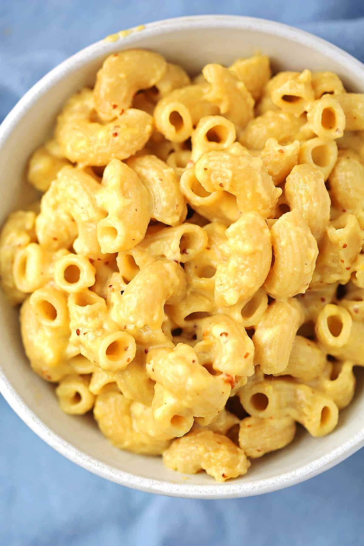 white bowl with creamy yellow mac and cheese