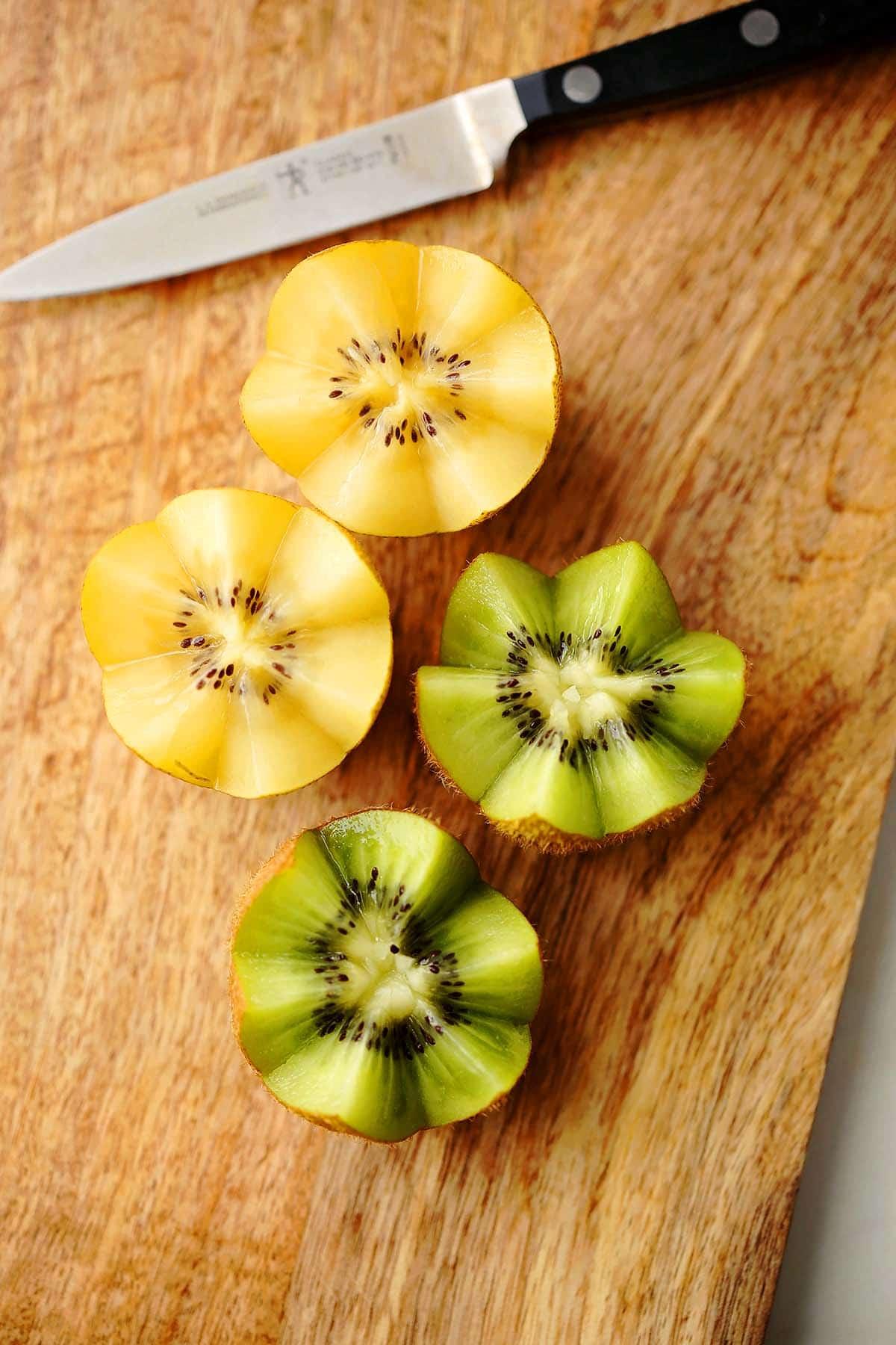 cutting board with kiwi fruit sliced in zigzag shape.