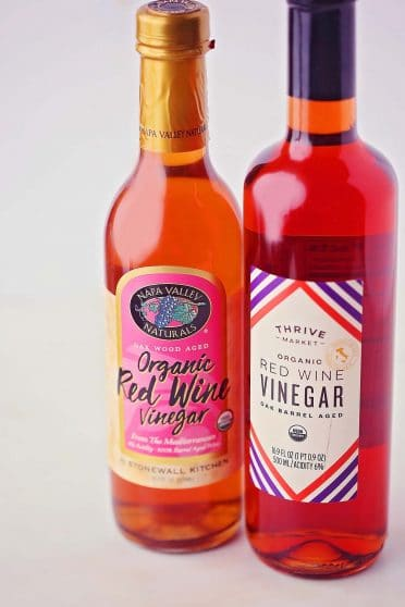 two bottles with bright red wine vinegar