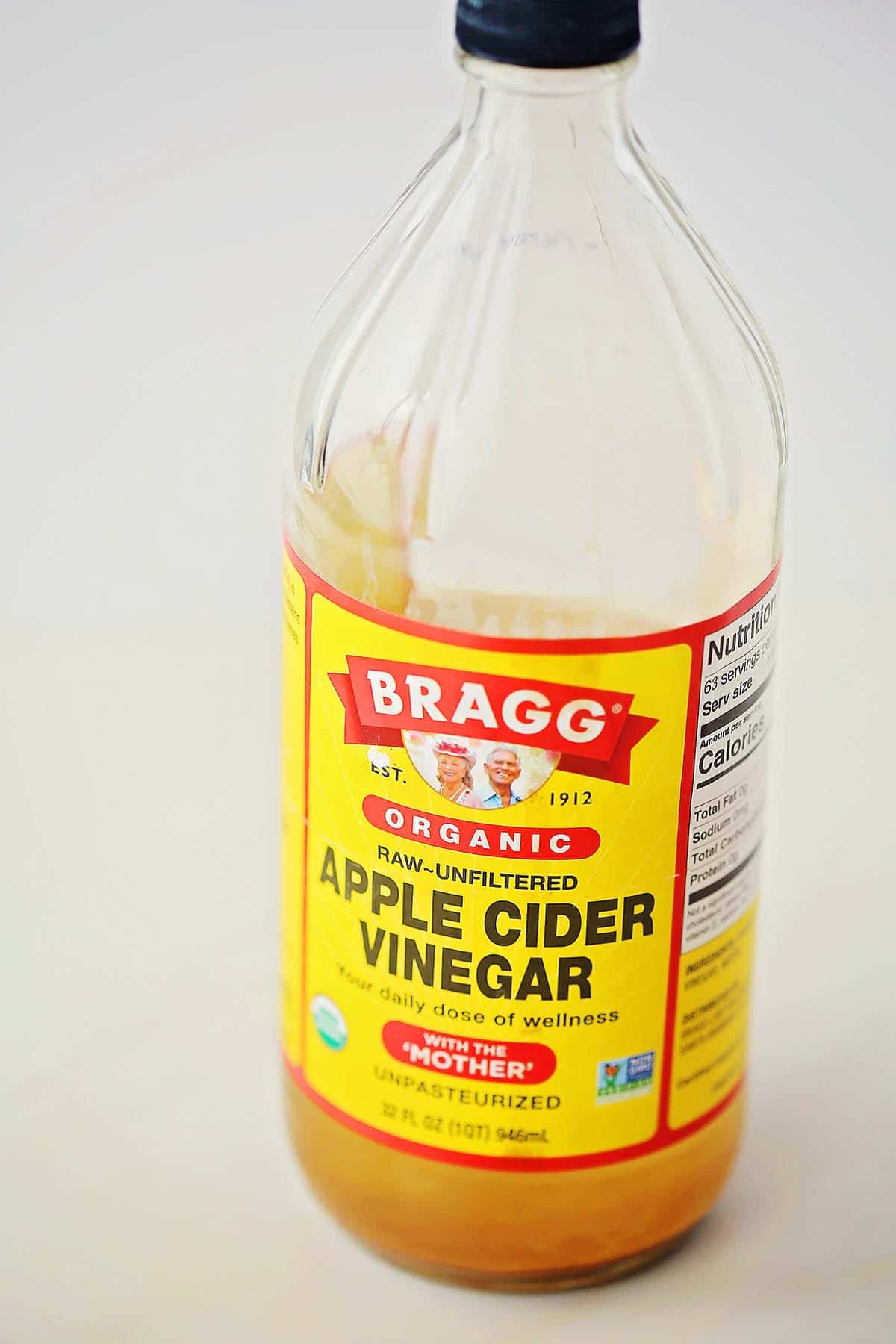 big glass bottle with apple cider vinegar
