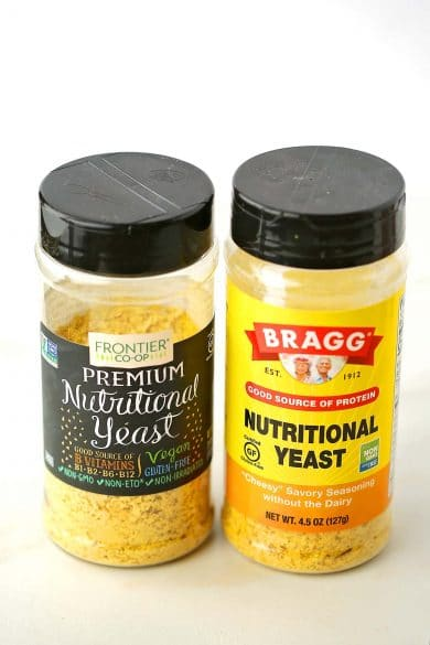two small bottles filled with yellow powder labeled Nutritional Yeast