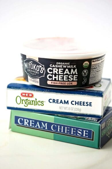 three different packages of cream cheese